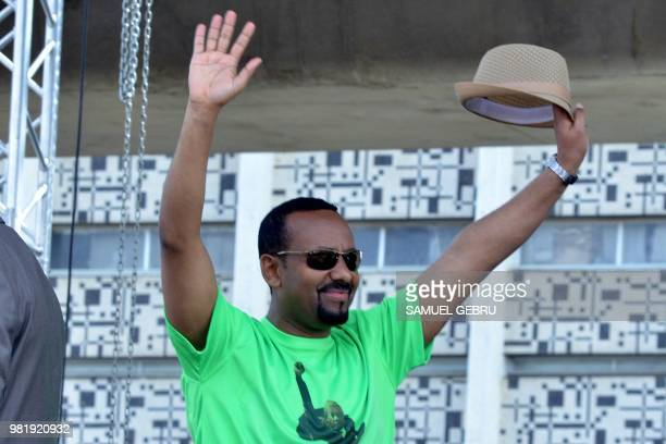 Ethiopia Prime Minister Abiy Ahmed waves to the crowd during a rally on Meskel Square in Addis Ababa on June 23 2018 A blast at a rally in Ethiopia's...