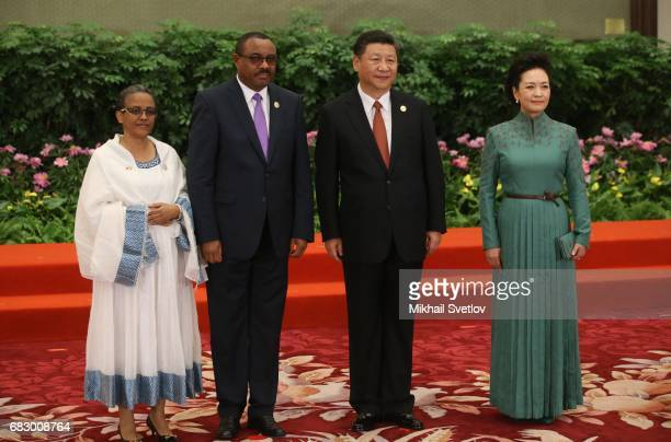 Ethiopia Prime Minister Hailemariam Desalegn his wife Roman Tesfaye Chinese President XI Jinping his wife Peng Liyan pose for a photo prior to the...