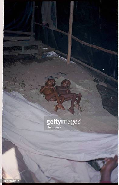 The bodies of children dead of starvation lie under a black plastic tent a makeshift morgue in the midst of the Ethiopian Famine at the Bati Feeding...