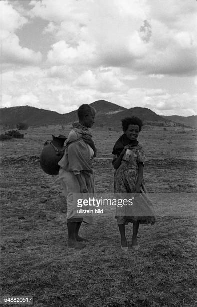 Women with water tanks