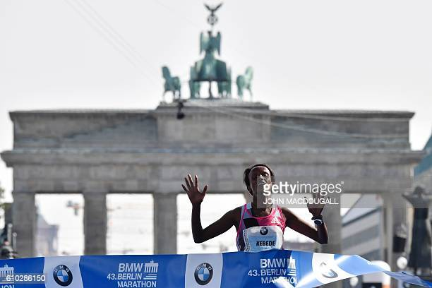 Ethiopian Aberu Kebede reacts while crossing the finish line to win the women's run of the 43rd Berlin Marathon in Berlin on September 25 2016 / AFP...