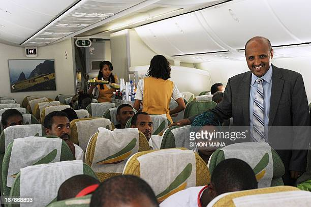 Ethiopian Airlines Chief Executive Officer Tewolde Gebremariam greets passengers onboard an Ethiopian Airlines 787 Dreamliner jet enroute to...