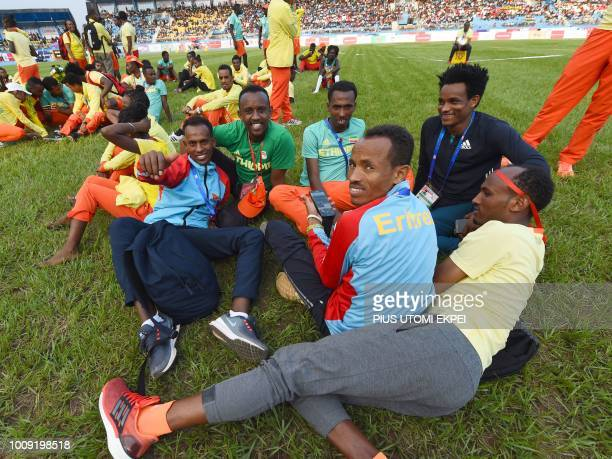 Ethiopian and Eritrean athletes relax before the opening of the 21st African Senior Athletics Championships at the Stephen Keshi Stadium in Asaba...