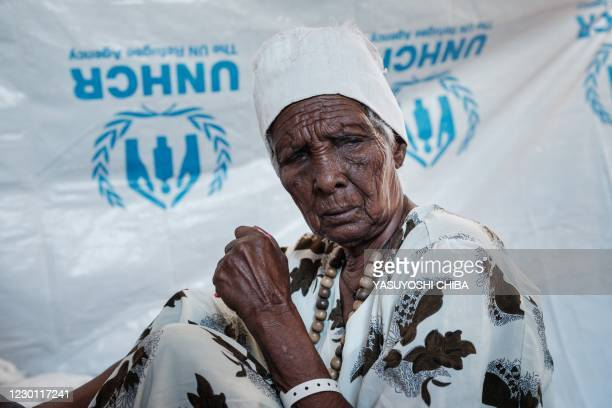 Ethiopian Asafu Alamaya, a 80-year-old blind who fled the Tigray conflict, sits in her makeshift shelter at the Um Raquba refugee camp in Sudan's...