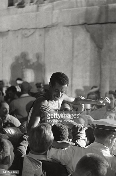 Ethiopian athlete Abebe Bikila rejoicing He's the gold medal winner in the marathon Rome 10th September 1960