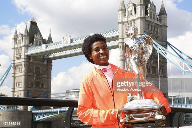Ethiopian athlete Tigist Tufa poses with her trophy during a photocall for the winners of the 2015 London Marathon in central London on April 27 2015...