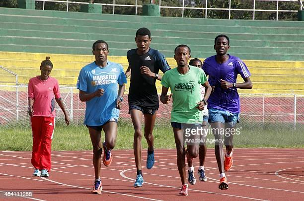 Ethiopian athletes are seen during a training session at the Addis Ababa Stadium in Addis Ababa Ethiopia on August 15 2015 ahead of the International...