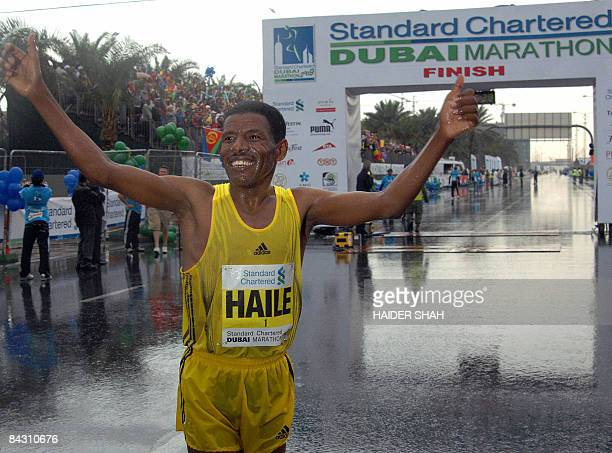 Ethiopian athletic legend Haile Gebrselassie celebrates after crossing the finish line of the Dubai Marathon 2009 the world's richest marathon in the...
