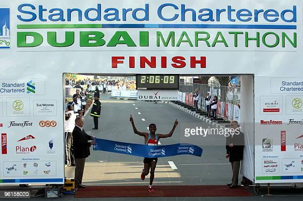 Ethiopian athletic legend Haile Gebrselassie celebrates after crossing the finish line of the Dubai Marathon 2010 in Dubai on January 22 2010 Despite...