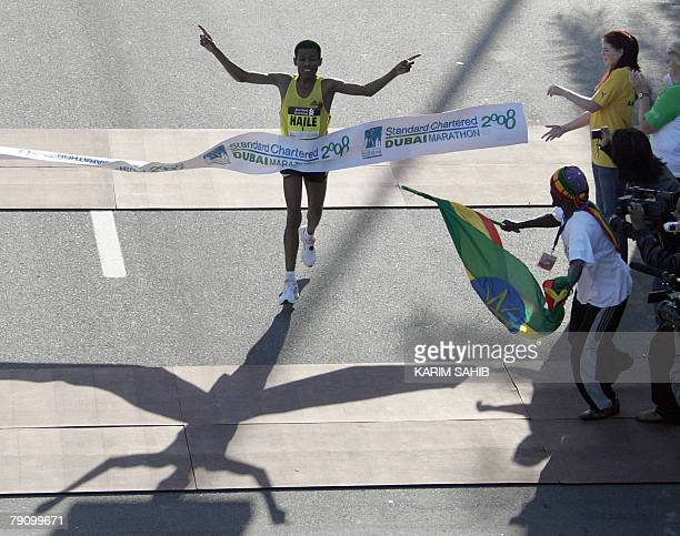 Ethiopian athletics legend Haile Gebrselassie crosses the finish line of the Dubai Marathon 2008 the world's richest marathon in Dubai 18 January...