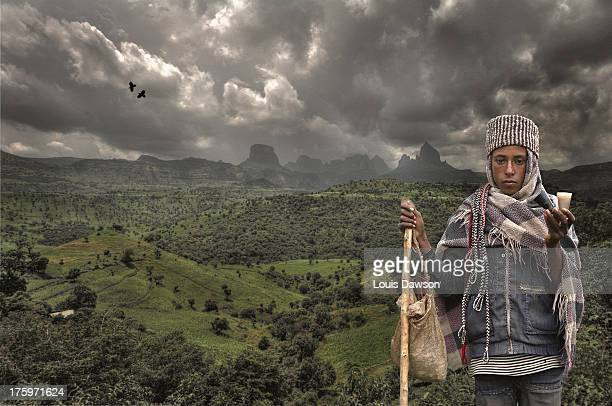 CONTENT] Ethiopian boy selling handmade crafts in Simien mountains Ethiopia