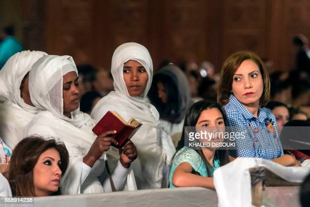 Ethiopian Christian Orthodox women attend an Easter mass led by of Egypt's Coptic Christian, Pope Tawadros II at the Saint Mark's Coptic Cathedral,...