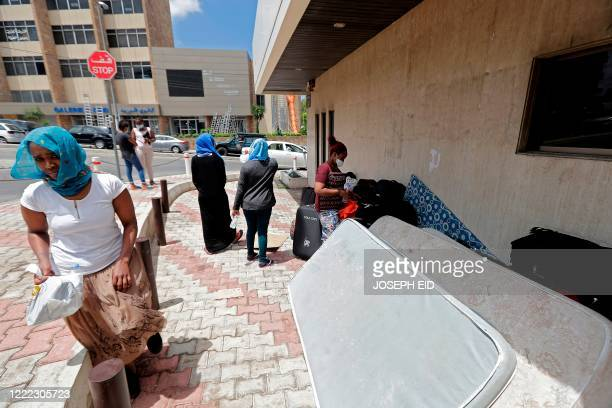 Ethiopian domestic workers who were dismissed by their employers gather with their belongings outside their countrys embassy in Hazmiyeh, east of...