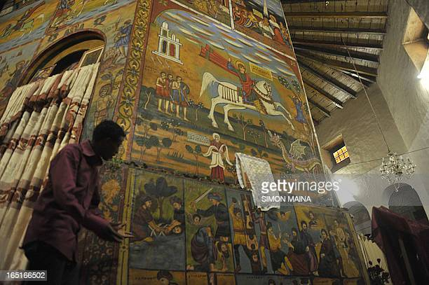 Ethiopian faithfuls read the bible before a mass at the St Raphael Coptic Orthodox in Entoto on the outskirts on May 27 2010 of the capital Addis...