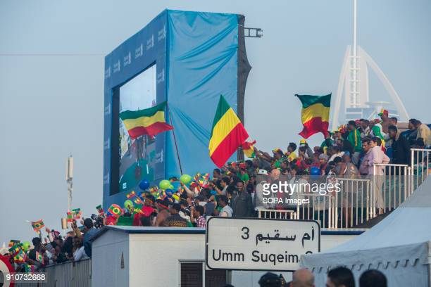 Ethiopian fans are celebrating the win of Mosinet Geremew in the men's race and Roza Dereje in the woman's race during the Standard Chartered Dubai...