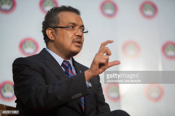 Ethiopian Foreign Minister Tedros Adhanom gestures as he delivers a speech after receiving an honourary degree during a ceremony at Addis Ababa...