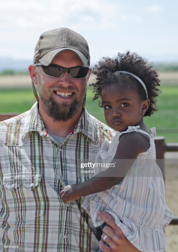 Ethiopian Girl and Her Adoptive Father : Stock Photo