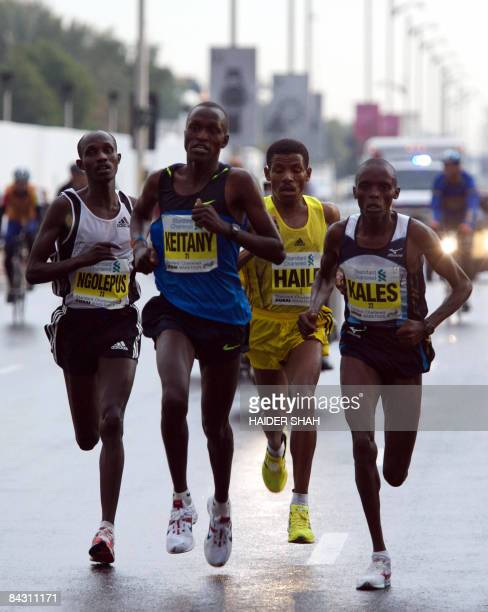 Ethiopian Haile Gebrselassie competes with fellow runners during the Dubai Marathon 2009 the world's richest marathon in the Gulf emirate on January...