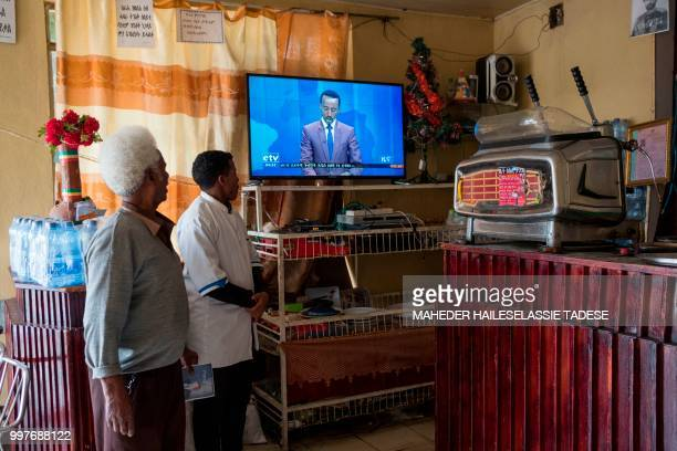 Ethiopian hotel owner Taeme Lemlem watches a television at his hotel which was once destroyed during the war between Ethiopia and Eritrea in...