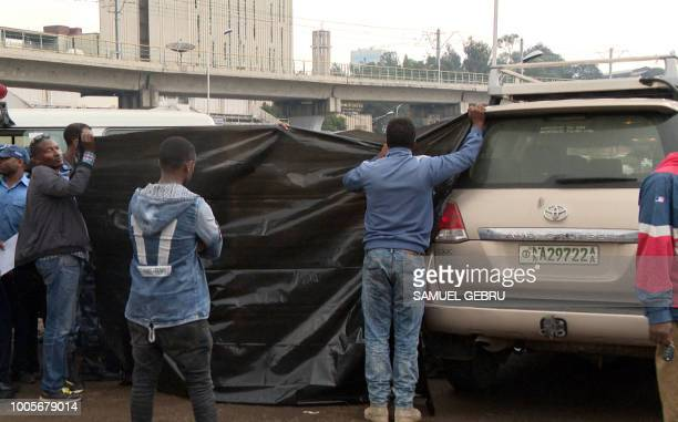 Ethiopian investigators cover the body of Simegnew Bekele the head of the controversial Grand Ethiopian Renaissance Dam on July 26 2018 who was found...