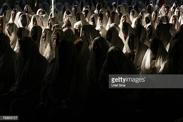 Ethiopian Jewish men wear prayer shawls as they pray in a synagogue on April 29 2007 in Gondar in northern Ethiopia Some 2500 Ethiopians of Jewish...