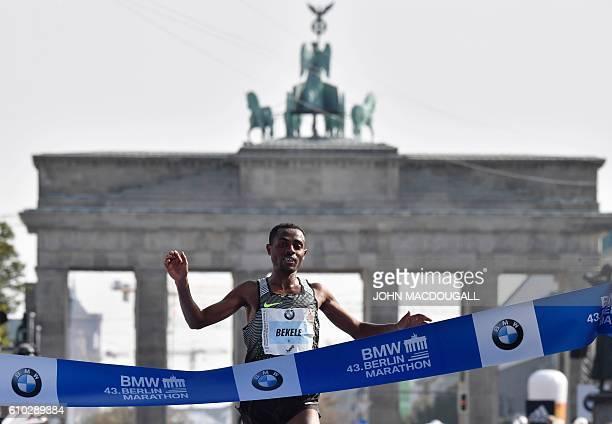 Ethiopian Kenenisa Bekele celebrates while crossing the finish line to win the 43rd Berlin Marathon in Berlin on September 25 2016 / AFP / John...