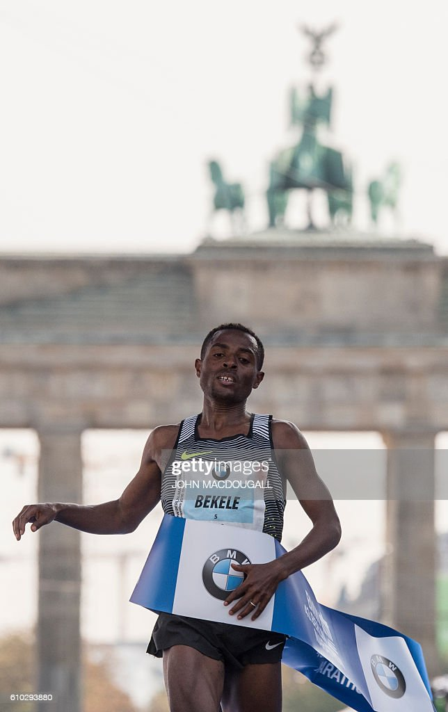 Ethiopian Kenenisa Bekele crosses the finish line to win the 43rd Berlin Marathon in Berlin on September 25, 2016. / AFP / John MACDOUGALL
