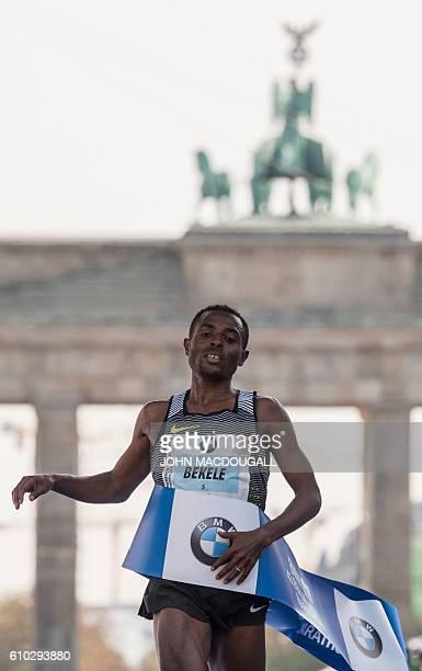 Ethiopian Kenenisa Bekele crosses the finish line to win the 43rd Berlin Marathon in Berlin on September 25 2016 / AFP / John MACDOUGALL