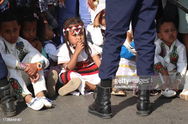 Ethiopian kids attend a parade to mark the 123rd anniversary of the battle of Adwa in which Ethiopia inflicted a crushing defeat on Italy's colonial...