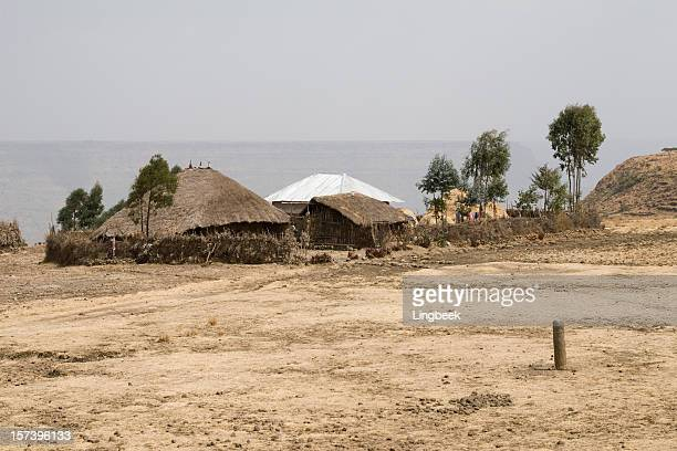 ethiopian landscape with a hut - loam stock photos and pictures