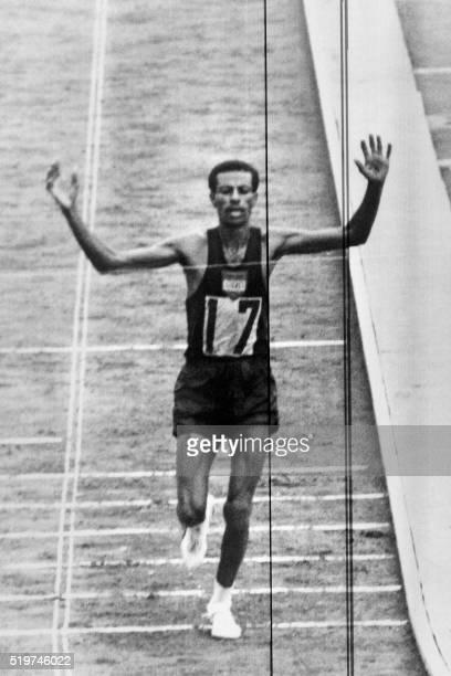 Ethiopian legendary athlete Abebe Bikila crosses victoriously the finish line of Tokyo Olympic games marathon on October 211964 in Tokyo / AFP /