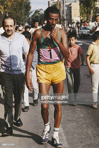 Ethiopian long distance runner Abebe Bikila , wearing bib number 1, competes in the Men's marathon at the 1968 Summer Olympics in Mexico City, Mexico...