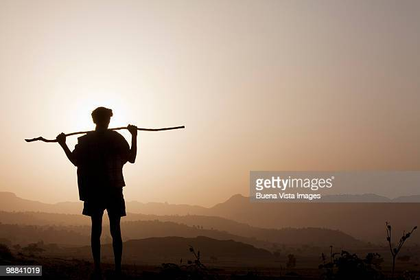 Ethiopian man watching sunrise