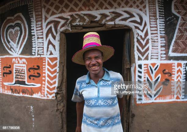 Ethiopian man with a hat standing in front of his traditional painted house Kembata Alaba Kuito Ethiopia on March 9 2016 in Alaba Kuito Ethiopia