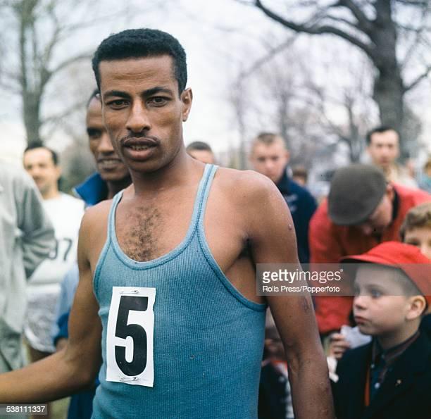 Ethiopian marathon runner Abebe Bikila pictured wearing a blue vest at a running event in 1963