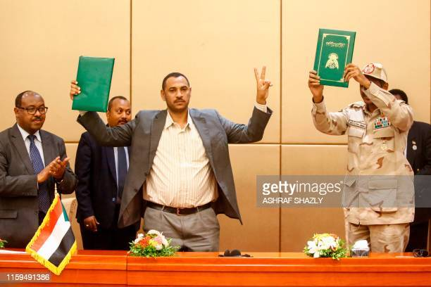 TOPSHOT Ethiopian mediator Mahmoud Drir protest leader Ahmad Rabie and General Mohamed Hamdan Daglo Sudan's deputy head of the Transitional Military...