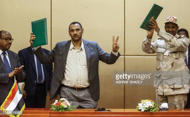 Ethiopian mediator Mahmoud Drir protest leader Ahmad Rabie and General Mohamed Hamdan Daglo Sudan's deputy head of the Transitional Military Council...