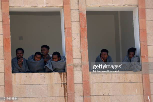 Ethiopian migrants are seen inside a building while undergoing quarantine as they across Yemen's land to reach Saudi Arabia on April 05, 2020 in...