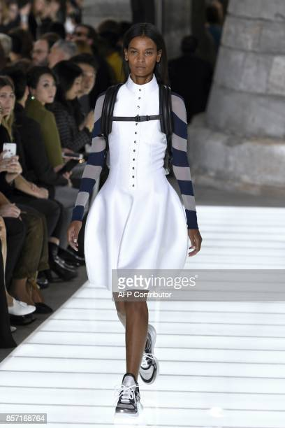 Ethiopian model Liya Kebede presents a creation for Louis Vuitton during the women's 2018 Spring/Summer readytowear collection fashion show in Paris...