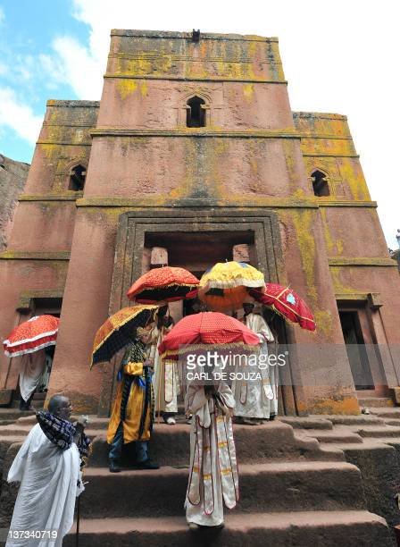 Ethiopian Orthodox Christian priests and monks leave mass at the Bete Giyorgis rockhewn church during the annual festival of Timkat in Lalibela on...