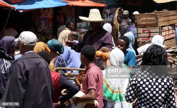 Ethiopian Orthodox Christians are seen at Sholla livestock market during the Holy Saturday ahead the Easter in Addis Ababa, Ethiopia on April 15,...