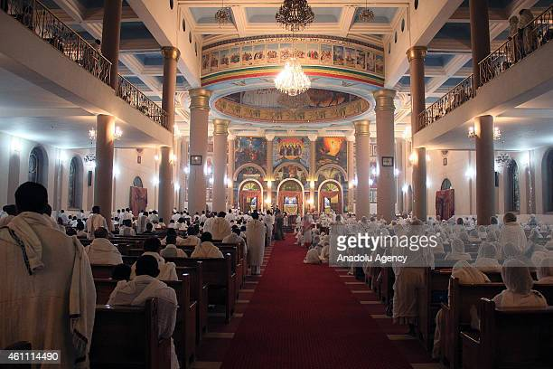 Ethiopian Orthodox Christians attend a Christmas mass at the Medehanialem Orthodox Church in Addis Ababa Ethiopia on January 6 2015 Orthodox...