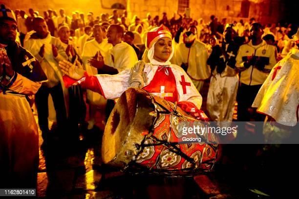 Ethiopian orthodox christians celebrating Easter vigil outside the Holy Sepulcher, Jerusalem, Israel.