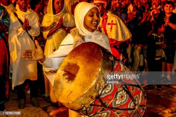 Ethiopian orthodox christians celebrating Easter vigil outside the Holy Sepulcher Jerusalem Israel