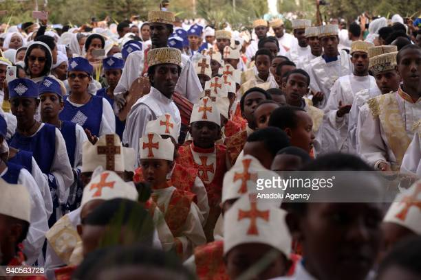 Ethiopian Orthodox Christians gather to attend the Hosanna Day celebrations ahead of the Easter at the Bole Medehanialem Church in Addis Ababa...