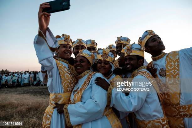 Ethiopian Orthodox christians take a selfie during the annual celebration of Timkat the Ethiopian Epiphany in Jan Meda sports ground in Addis Ababa...