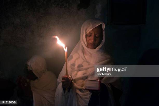 Ethiopian Orthodox Christians take part in the ceremony of the Holy Fire at the Ethiopian section of the Church of The Holy Sepulcheron April 7 2018...