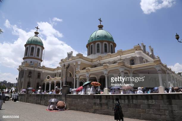 Ethiopian Orthodox Christians take part in the religious mass during the Good Friday at the Medhane Alem Cathedral in Addis Ababa Ethiopia on April...