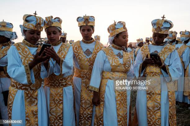 Ethiopian Orthodox christians use smartphones during the annual celebration of Timkat the Ethiopian Epiphany in Jan Meda sports ground in Addis Ababa...