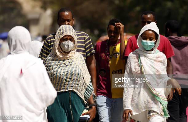 Ethiopian Orthodox Christians wearing face masks as a preventive measure against the coronavirus pandemic make their way to attend the Hosanna Day...